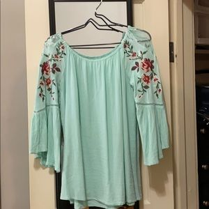 Turquoise top with embroidery details